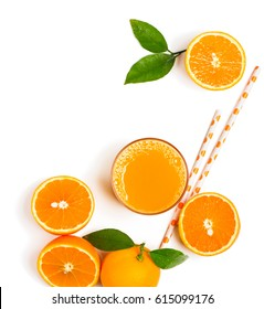 Top view of orange fruits with green leaves and freshly squeezed orange juice  isolated on white background.