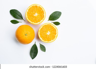 Top view of orange fruits and leaves isolated on white background. Juicy and sweet and renowned for its concentration of vitamin C