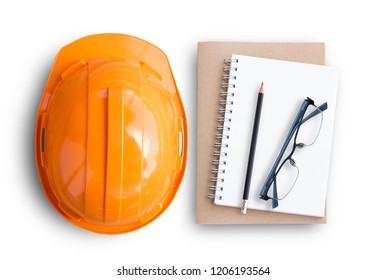 Top view with orange safety engineer helmet and blank notebook or notepad and pencil on white background or office desk background.