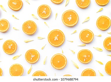 Top view of orange slice with flower petal on white background.fruit and summer concept idea.flat lay design