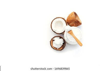 Top view Organic healthy coconut butter in jar with fresh coconut pieces over  white background
