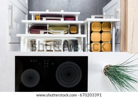 Top View Of Organized Kitchen Drawers And Electric Kitchen Stove. Modern Kitchen  Organization Of Spaces