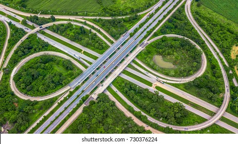 Top view over the highway, aerial view interchange of a city, Shot from drone, Expressway is an important infrastructure.