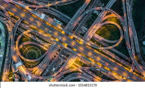 Top view over the highway, expressway, motorway at night, Aerial view interchange of a city.