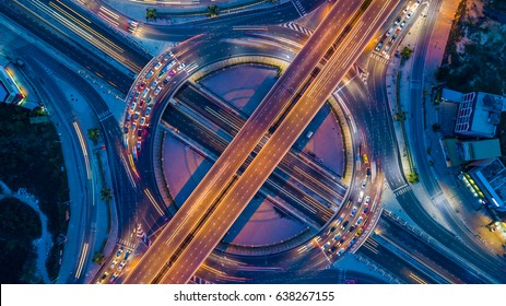 Top view over the highway, expressway and motorway at night, Aerial view interchange of a city.