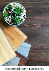 Top view over vinyl wood plank color choosing for floor tiles design idea