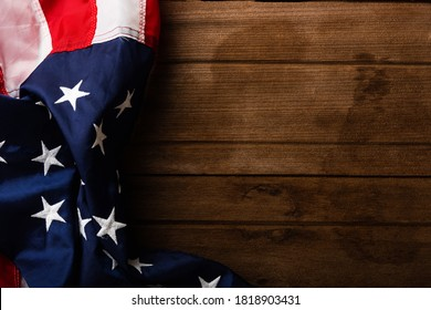 Top view overhead America United States flag, memorial remembrance and thank you of hero, studio shot with copy space on wooden table background, USA holiday Veterans or Independence day concept
