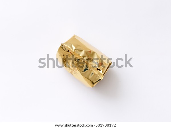 top view of packaged various chocolate pralines on white background