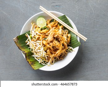 Top view pad thai of thai food noodles style and street food on wooden table