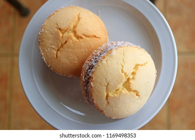Top view of a pair of Alfajores, traditional Latin American sweets served on glass top table