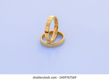 Top view of a pair of gold rings - Engagement rings insulated on a white background - Beautiful pair of wedding rings