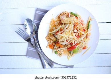 Top view Papaya salad on white background