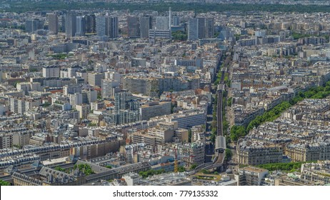 Top view of Paris skyline from above timelapse. Main landmarks of european megapolis with Boulevard de Grenelle and metro line. Bird-eye view from observation deck of Montparnasse tower. Paris, France