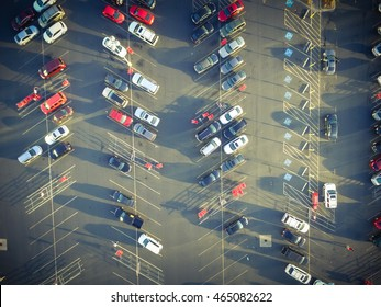 Top view parking lots with rows of parked car, shopping carts, road sign for disabled drivers at a supermarket in Houston, Texas, USA at sunset.Urban infrastructure and transportation concept. Vintage