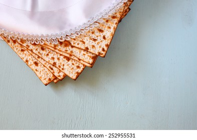 top view of passover background. matzoh (jewish holiday bread) and traditional seder plate over wooden board