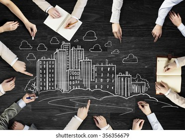 Top view of people hands drawing teamwork strategy