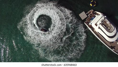 Top View of People Having Fun on Jetski and Catamaran