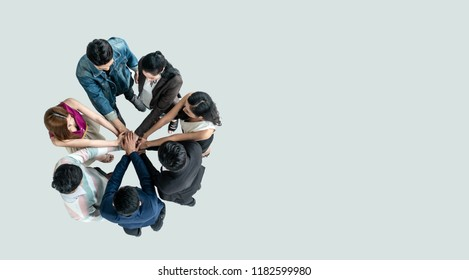 Top view of people in team stack hands together as unity and teamwork in office. young Asian team and group togetherness collaboration