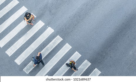 From the top view of people walk on street pedestrian crossroad in the city street ,bird eye view.