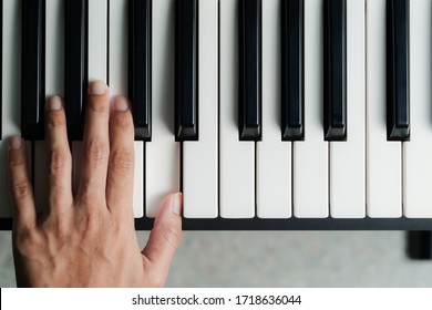 Top view of the person playing the piano