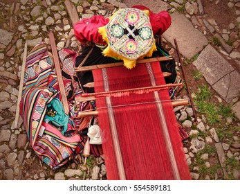 Top view of peruvian woman in traditional clothes at work