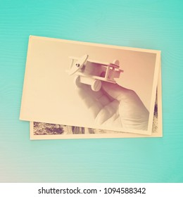 top view of photo collage on wooden background. vintage filtered image