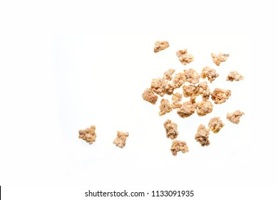 Top view photo of granola pile isolated on white background, muesli texture, scattered crumb pattern, cereal grain for good health