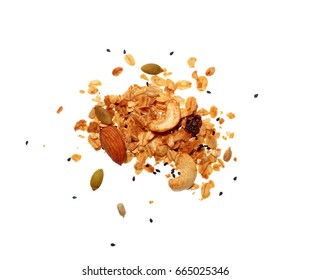 Top view photo of granola pile isolated on white background, muesli texture, scattered seeds pattern, cereal grain for healthy
