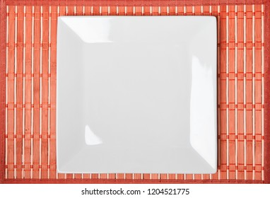 Top view photo of a square white dish