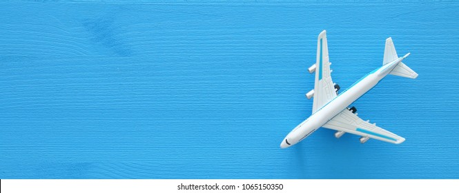 top view photo of toy airplane over blue wooden background