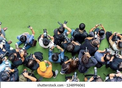 Top view of photographer work for event.