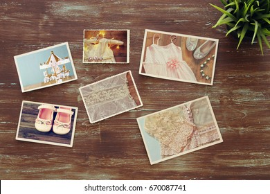 top view of photos collage on wooden background. vintage filtered image