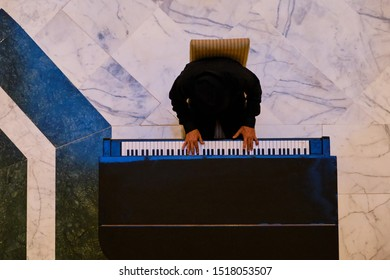 Top view of the pianist playing a musical instrument