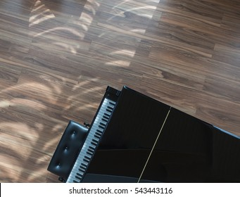 Top view of a piano keyboard with wooden floor background in vintage .