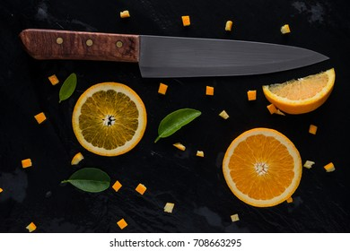 top view of piece orange and knife on slate stone.  fresh fruit  concept