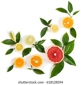 Top view of pieces of lemon, lime, grapefruit and orange with leaves isolated on white background.