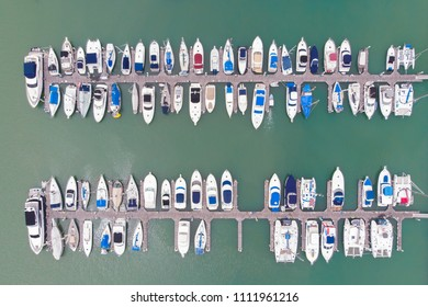 Top view of pier, Many speedboats and yachts in pier. Captured by drone