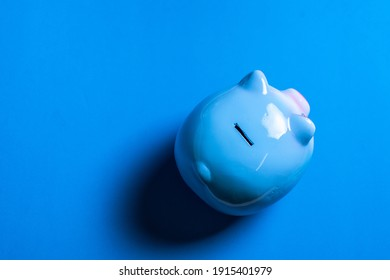 top view of piggy bank isolated on purple background