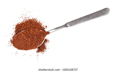 top view of pile of freshly ground coffee in spoon isolated on white background