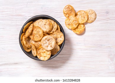 Top view pile of organic, crispy, baked, whole grain rice chips