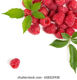 Top view of pile of organic red ripe mellow raspberry berries and green leaves isolated on white background.