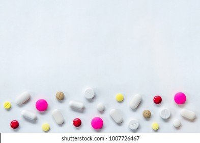 Top view of the pills on the white background, The drug and capsule pills on the floor, Pile of the drug and pills on the white background.