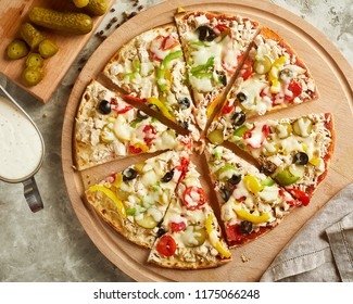Top view of pizza with cheese, tomato and olives