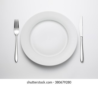 Top view of place setting with plate, knife and fork, with clipping path