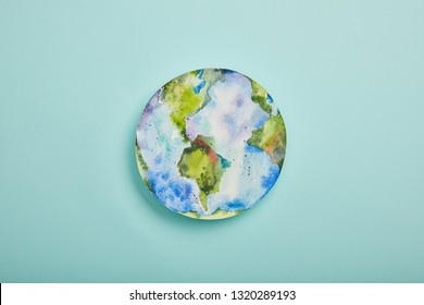 top view of planet picture on turquoise background, earth day concept