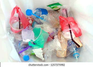 top view of plastic bottle water drink waste and straws in recycle bin dirty, pile of garbage plastic waste bottle and bag cup many on bin bag, plastic waste pollution, garbage, trash dump