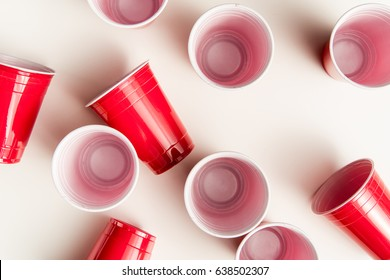 top view of plastic disposable cups isolated on white