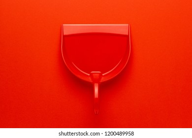 top view of plastic dustpan on red background