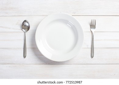 top view of plate on white wooden table