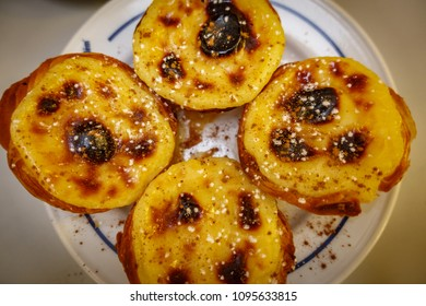 Top view of plate with pasteis de nata, typical Portuguese egg tart pastries